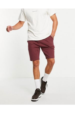 ASOS DESIGN Pleated jersey shorts in red-Grey