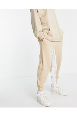ASOS DESIGN Co-ord oversized joggers with inside stripe-Neutral