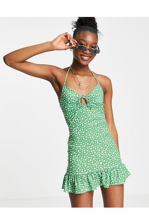 ASOS DESIGN Halter ring front detail mini dress in green and white floral
