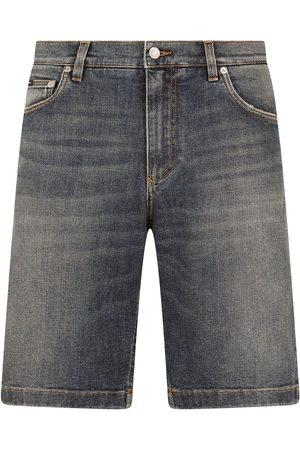 Dolce & Gabbana Homem Calções - Faded-effect denim shorts