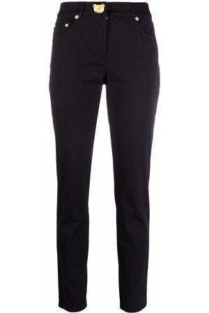 Moschino Teddy-plaque slim-cut trousers