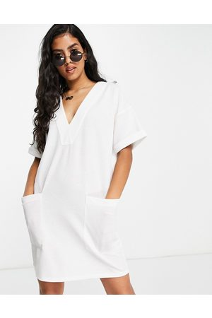 ASOS DESIGN Oversized linen look v neck t-shirt dress with pockets in ivory-White