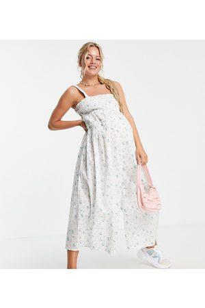 ASOS Maternity ASOS DESIGN maternity shirred elastic back jumpsuit in meadow floral-Multi