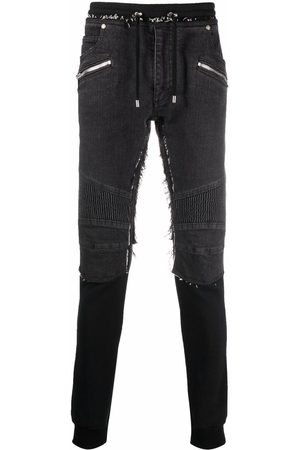 Balmain Layered-effect raw-cut trousers