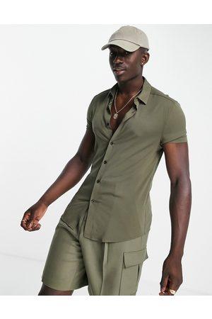 ASOS DESIGN Skinny viscose shirt in khaki-Green