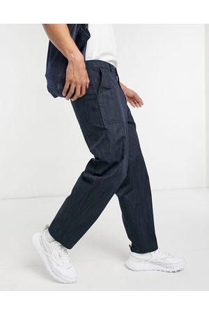 ASOS Homem Calças Cargo - Carpenter trousers in wide fit in texture fabric-Navy
