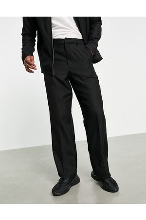 ASOS Homem Calças à Boca-de-sino - Smart wide leg trousers with leopard jacquard in black-Blue