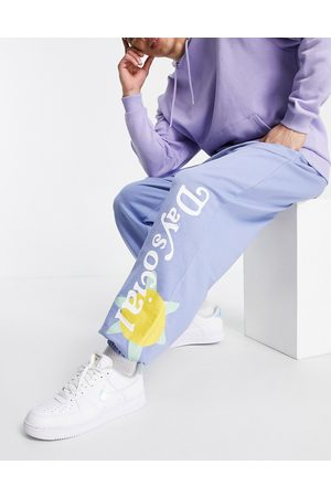 ASOS Homem ASOS Daysocial co-ord oversized jogger with multi placement graphic flower prints in blue