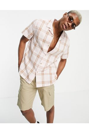 ASOS DESIGN Relaxed revere linen shirt in pink & brown check