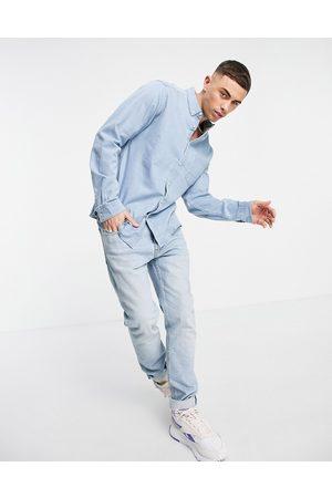 ASOS Homem Ganga - Slim denim shirt in light wash-Blue