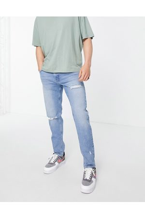 ASOS Stretch slim jeans in mid wash with rips-Blue