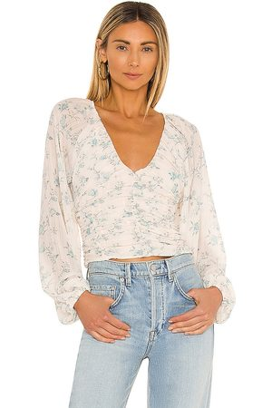 Free People New Final Rose Blouse in - White. Size L (also in XS, S, M, XL).