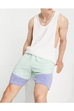 ASOS DESIGN Co-ord oversized towelling colour block shorts in blue-Green