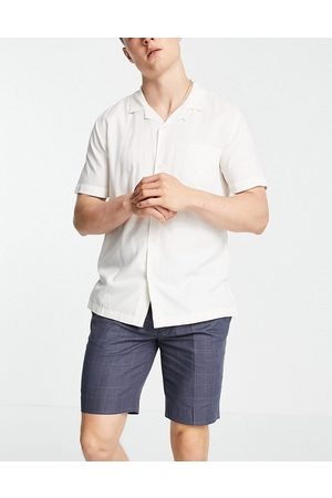 ASOS DESIGN Tapered smart shorts in navy check