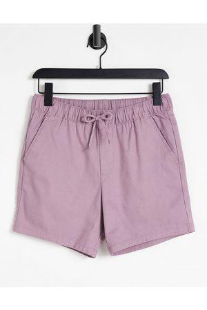 ASOS Homem Calções - Skinny chino shorts with elasticated waist in purple