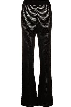 Nanushka Bazia crochet-knit slim trousers