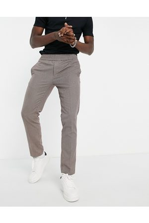 River Island Homem Joggers - Smart joggers in heritage brown check