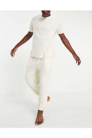 ASOS DESIGN Fluffy pyjama set with oversized jogger and t-shirt in beige-Neutral