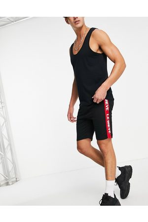 Le Breve Lounge co-ord shorts in black with red tape
