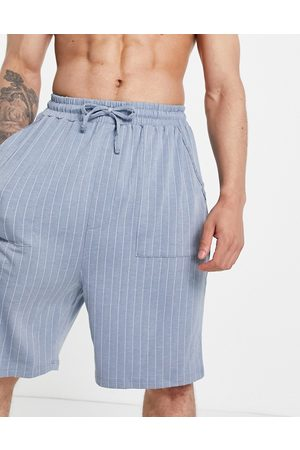 ASOS DESIGN Lounge shorts in striped blue and white