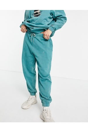 ASOS DESIGN Co-ord oversized joggers in green acid wash