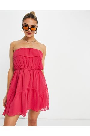 ASOS DESIGN Ruffle bandeau mini skater dress with belt in dobby in hot pink