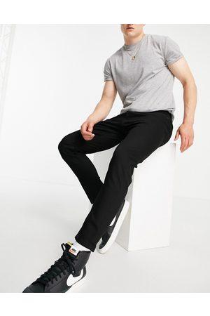 Topman Stretch taper jeans in black
