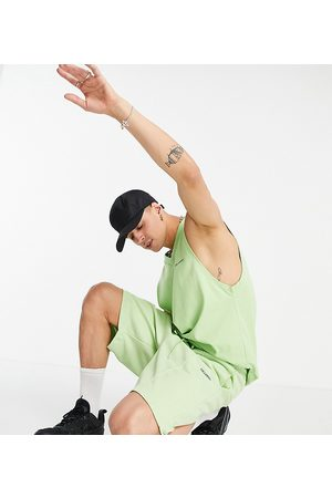 Collusion Oversized poly tricot shorts in green co-ord