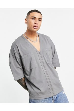ASOS Oversized half sleeve jersey shirt with double pockets in washed black