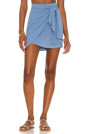 Indah Cassiel Sarong Mini Skirt in - Blue. Size L (also in S, XS, M).