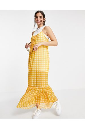 ASOS DESIGN Strappy maxi 2 in 1 sundress with pep hem in yellow gingham print
