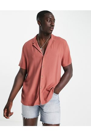 ASOS DESIGN Relaxed viscose shirt with revere collar in brick-Red