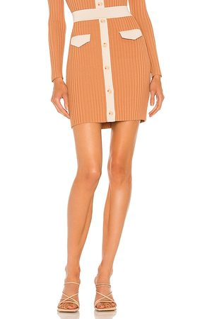 JONATHAN SIMKHAI Heather Compact Cut Out Mini Skirt in - Tan,Peach. Size L (also in XS, S, M).
