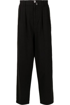 Undercoverism Pleat-detail buttoned tailored trousers