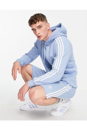 adidas Homem Calções desportivos - Adicolor three stripe shorts in light blue