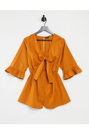 ASOS Knot front frill sleeve playsuit in tan-Brown