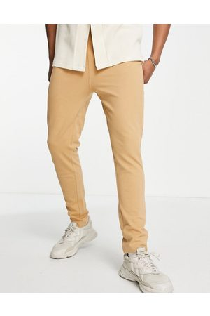 Only & Sons Co-ord herringbone texture slim fit joggers in tan-Brown