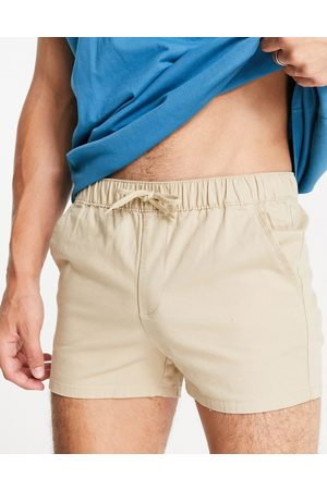 ASOS Chino shorter shorts in slim fit with elasticated waist in beige-Neutral