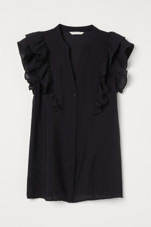 H&M MAMA Blusa com mangas de folho