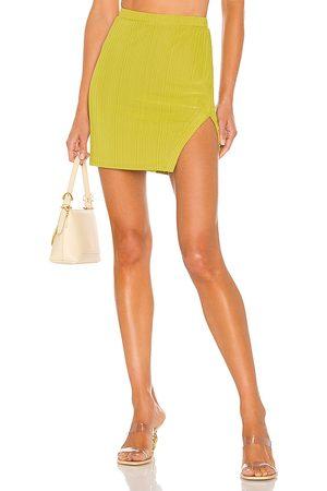 Camila Coelho Bennie Mini Skirt in - Green. Size L (also in XXS, XS, S, M, XL).