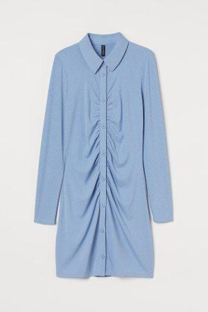 H&M Vestido camiseiro em jersey
