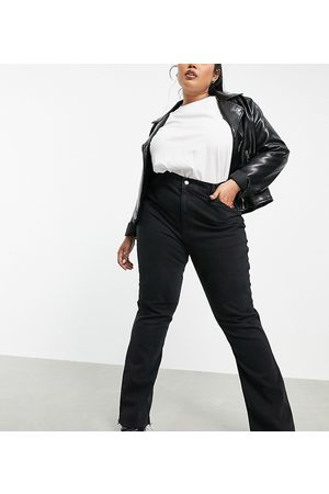 ASOS Curve ASOS DESIGN Curve high rise '70's' stretch flare jeans in washed black