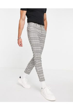 New Look Homem Calças Justas - Cropped slim suit trousers in grey check