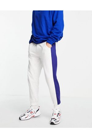 ASOS DESIGN Co-ord oversized joggers with printed side stripe-White