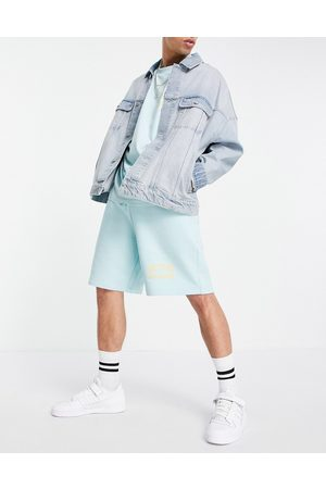 ASOS Athlesiure co-ord relaxed short with logo print in canal blue