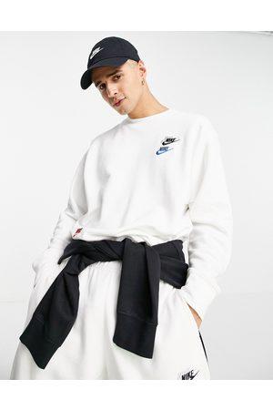 Nike Essential fleece+ multi logo crew neck sweatshirt in white