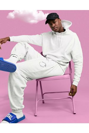 ASOS Homem Joggers - Athleisure oversized jogger in white marl with health and wellbeing print