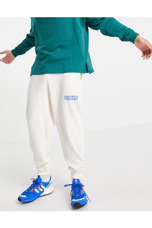 Crooked Tongues Homem Joggers - Logo relaxed jogger in ecru-White