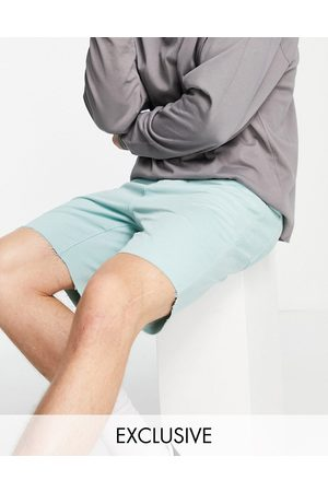 COLLUSION 90s vintage shorts in washed blue