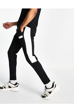 BOSS Athleisure Homem Joggers - Hadiko Batch logo joggers with contrast side panel in black